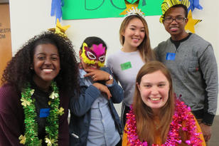 """Students posing with fun props and a background that reads """"BSP"""""""